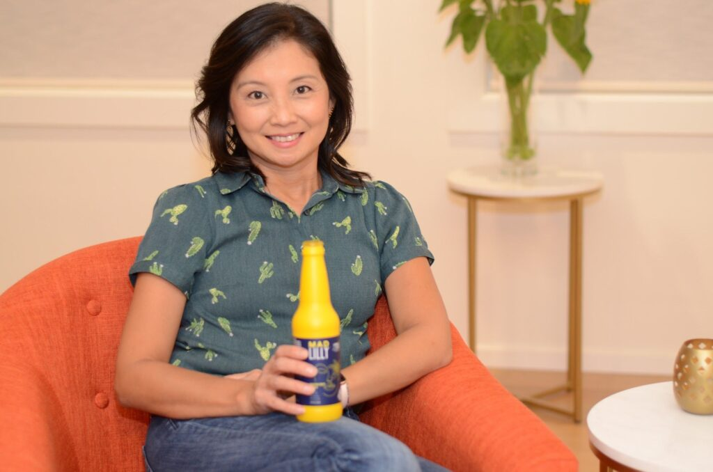 founder judy yee sitting with her product